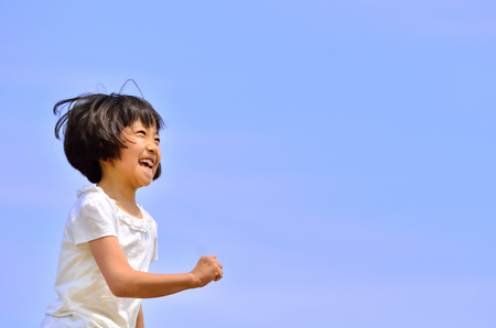 Girl running (blue sky)
