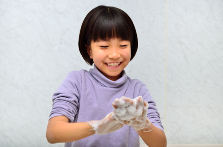 upper school: Girl washing hands Stock Photo