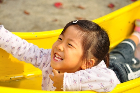 upper school: A girl playing at the playground in the Park Stock Photo
