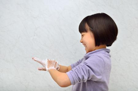 Girl washing hands 스톡 콘텐츠