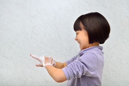 Girl washing hands Stock Photo