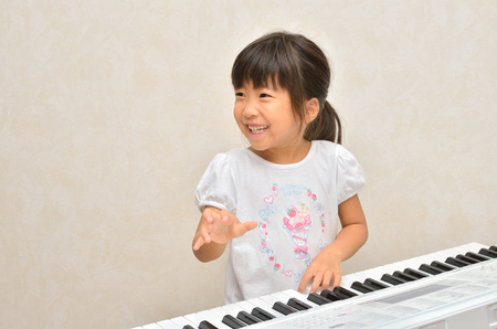 Girls playing the piano