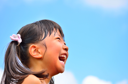 Girls laughing in the sky Stock Photo