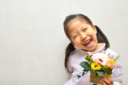 upper school: Bouquet of flowers with a sweet smile girl Stock Photo