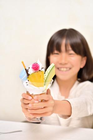 parfait: Girl eating delicious Parfait