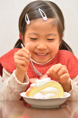 upper school: Girl eating delicious Cake Stock Photo