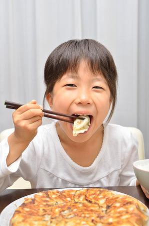 Girls eat delicious chinese dumplings