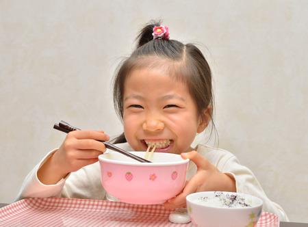 Girls eat delicious noodles