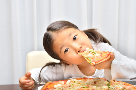 Girl eating delicious pizza 스톡 콘텐츠