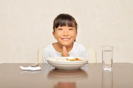 upper school: Girls eat curry Stock Photo