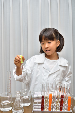 volumetric flask: Science for girls Stock Photo