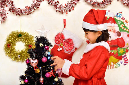christmas costume: Santa Claus costume to enjoy the Christmas party girl Stock Photo