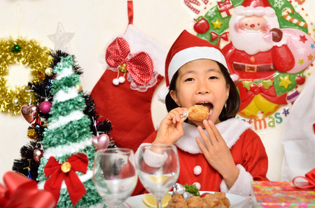fancy dress party: Santa Claus costume to enjoy the Christmas party girl Stock Photo