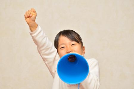 Girls cheer by megaphone