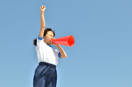 Girls cheer at the blue sky (gym uniform, megaphone)