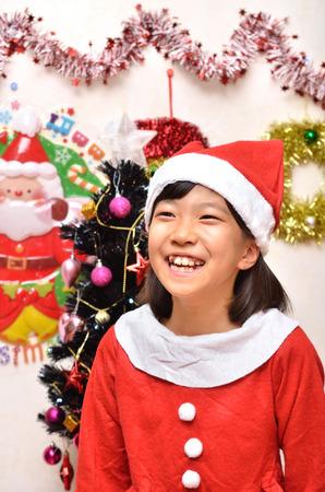 santa claus costume: Girls enjoy Christmas party (Santa Claus costume) Stock Photo