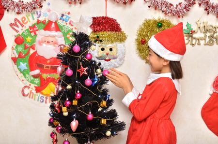 christmas costume: Girls enjoy Christmas party (Santa Claus costume) Stock Photo