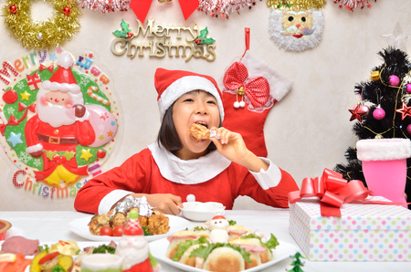 fancy dress party: Girls enjoy Christmas party (Santa Claus costume) Stock Photo