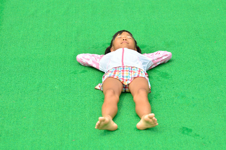 lie down: Girl lie down at poolside