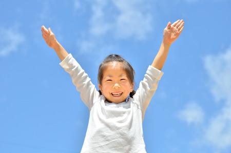 raises: Girl raises hands in the sky Stock Photo