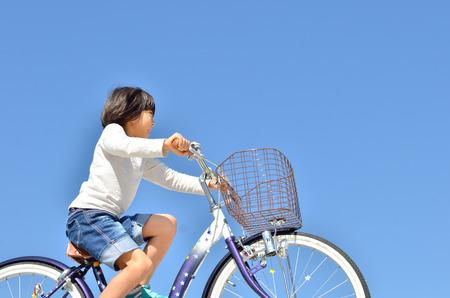 Girl ride on a bike