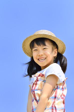Girl smile in the blue sky (straw hat)