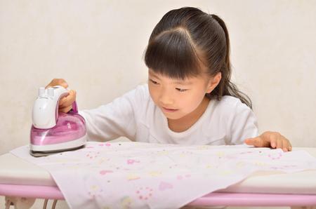 handkerchief: Girl iron handkerchief Stock Photo