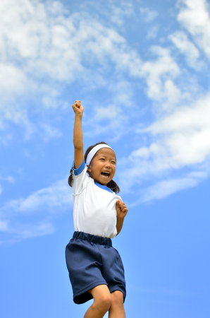 sports day: Girl cheering in the blue sky (Sports day) Stock Photo