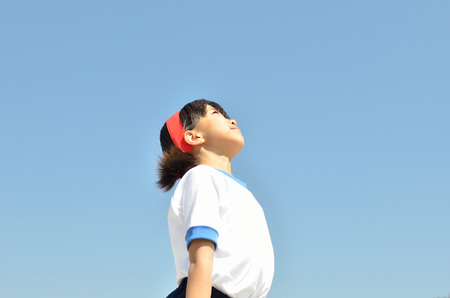 sports day: Girl look up (Sports day) Stock Photo