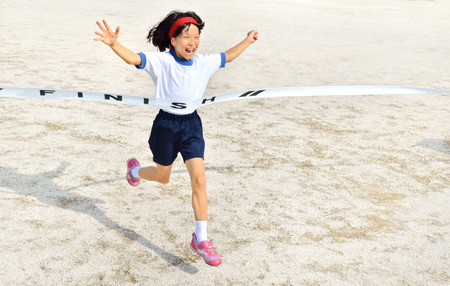 sports day: Girl finish the goal line (Sports day) Stock Photo