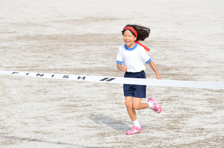 Girl finish the goal line (Sports day) 스톡 콘텐츠