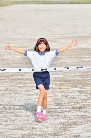 goal line: Girl finish the goal line (Sports day) Stock Photo
