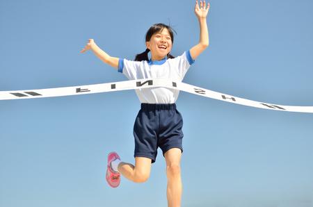 goal line: Girl finish the goal line (Sports day blue sky) Stock Photo