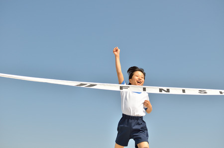 sports day: Girl finish the goal line (Sports day blue sky) Stock Photo