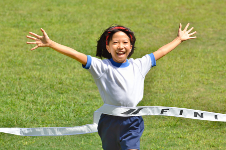 goal line: Girl finish the goal line (Sports day grassland)