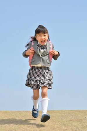 The first grade girl running