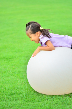 Girl playing with a ball Stock Photo