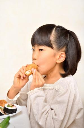 Girl enjoy japanese cuisine