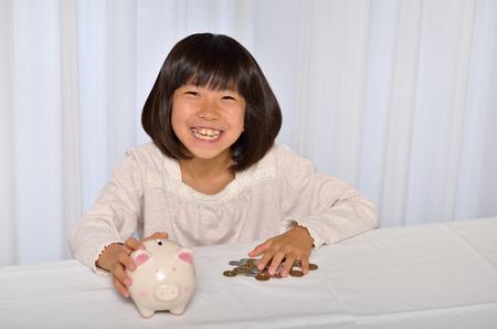 Girl save coins Stock Photo