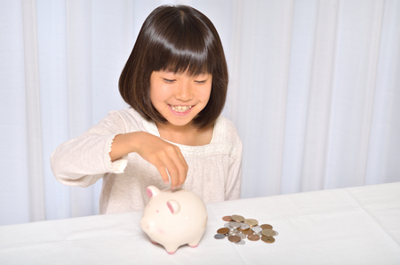 Girl save coins Stock Photo