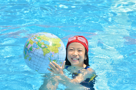Girls hold earth in the swimming pool
