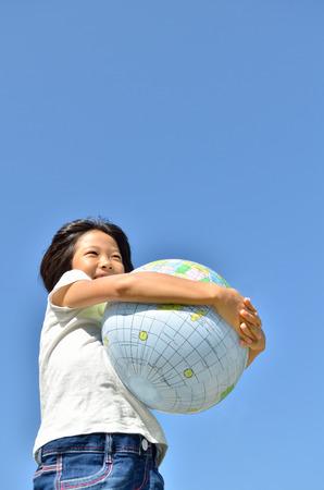 Girls hold earth