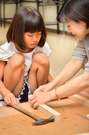 Parents and children enjoy woodworking