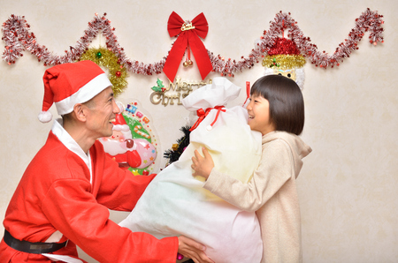 Parents and children enjoy the Christmas party Stock Photo