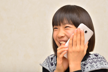 Girl talking on the mobile phone 스톡 콘텐츠