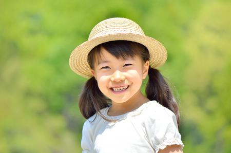 Smiling girls (straw hat)