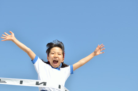 Girl finish the goal line (Sports day) Stock Photo