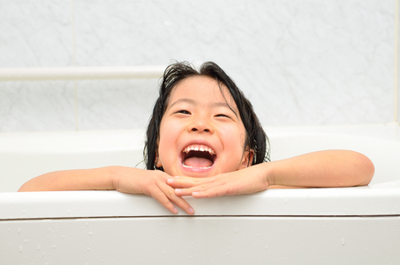bathe: Girls take a bath