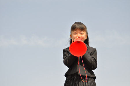 1 person: The first grade girl cheering in the blue sky