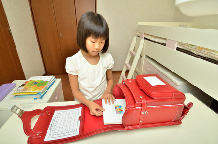 Girl prepare for school Stock Photo